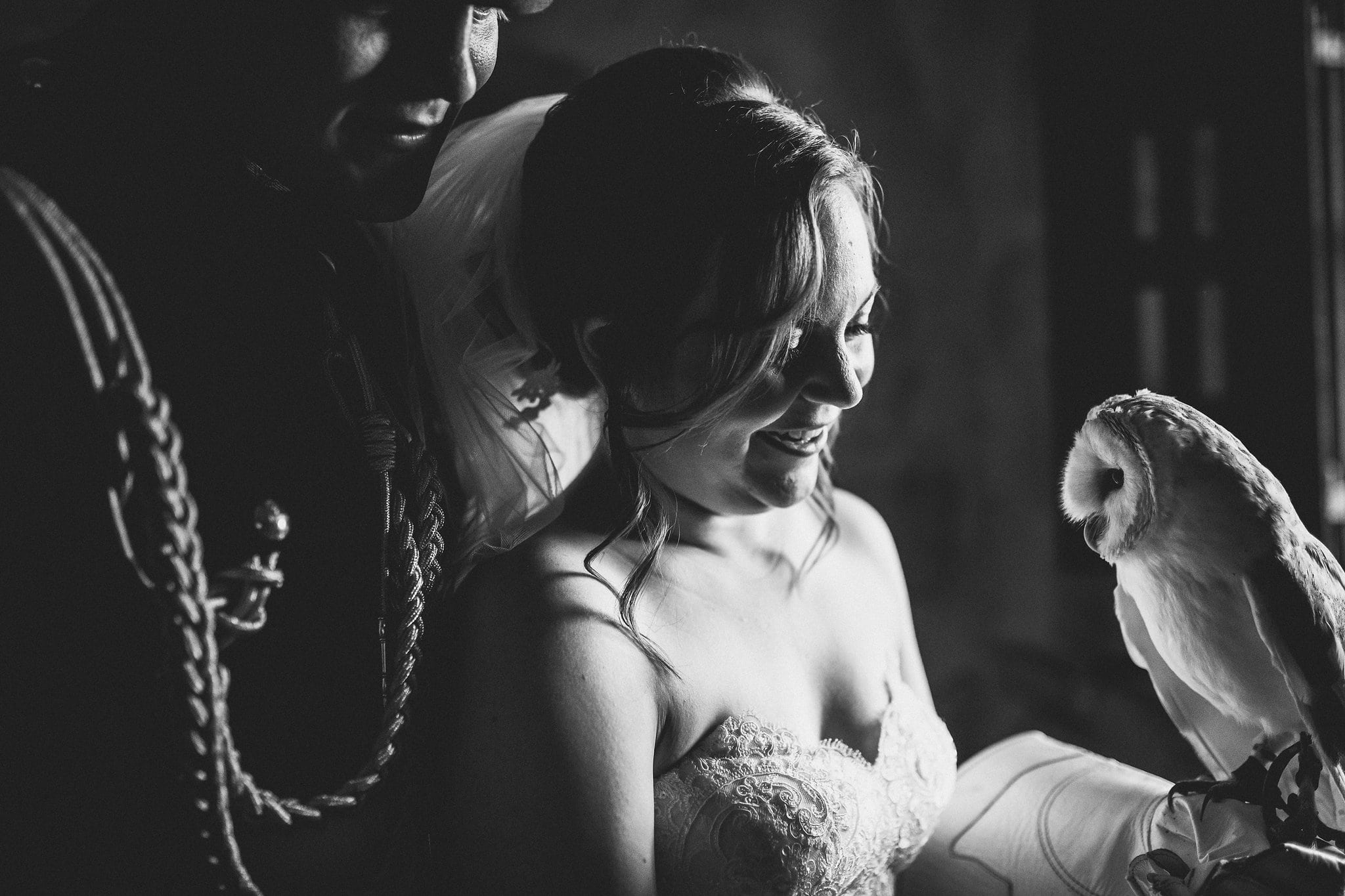 Black and white shot of bride, groom and barn owl