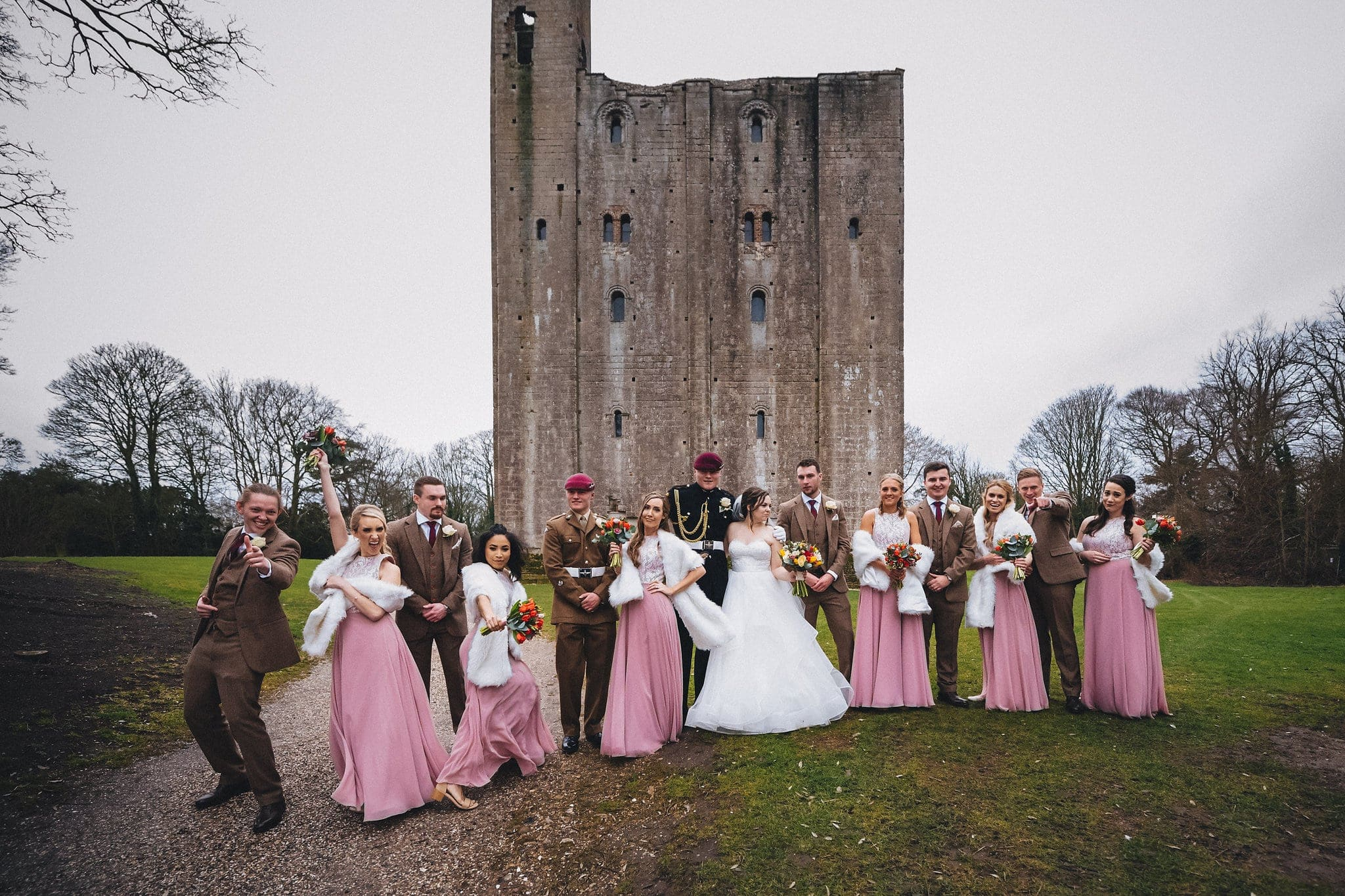 Group shot of bridal party outside Hedingham Castle