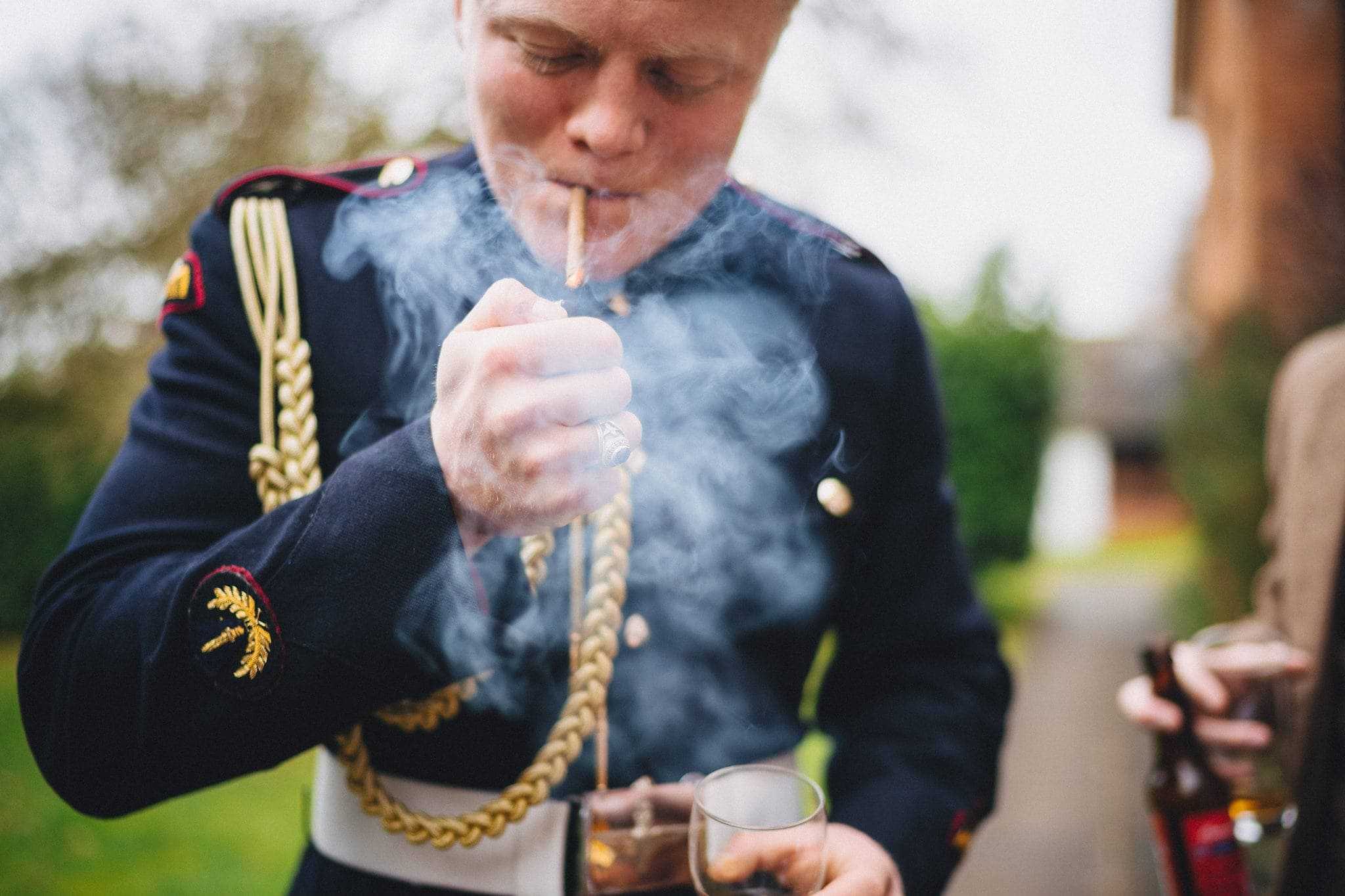 Military Groom smokes cigar