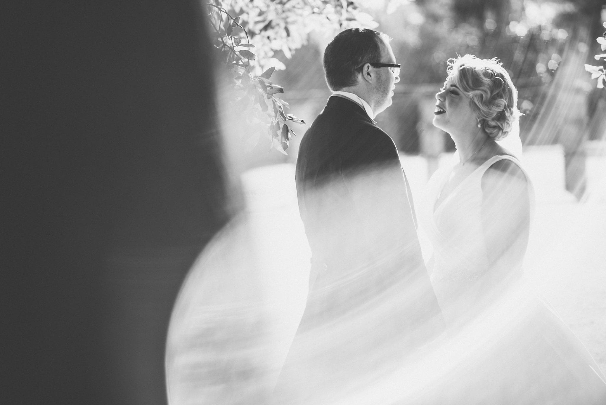 Black and white portrait of bride and groom in woodland at Shendish Manor