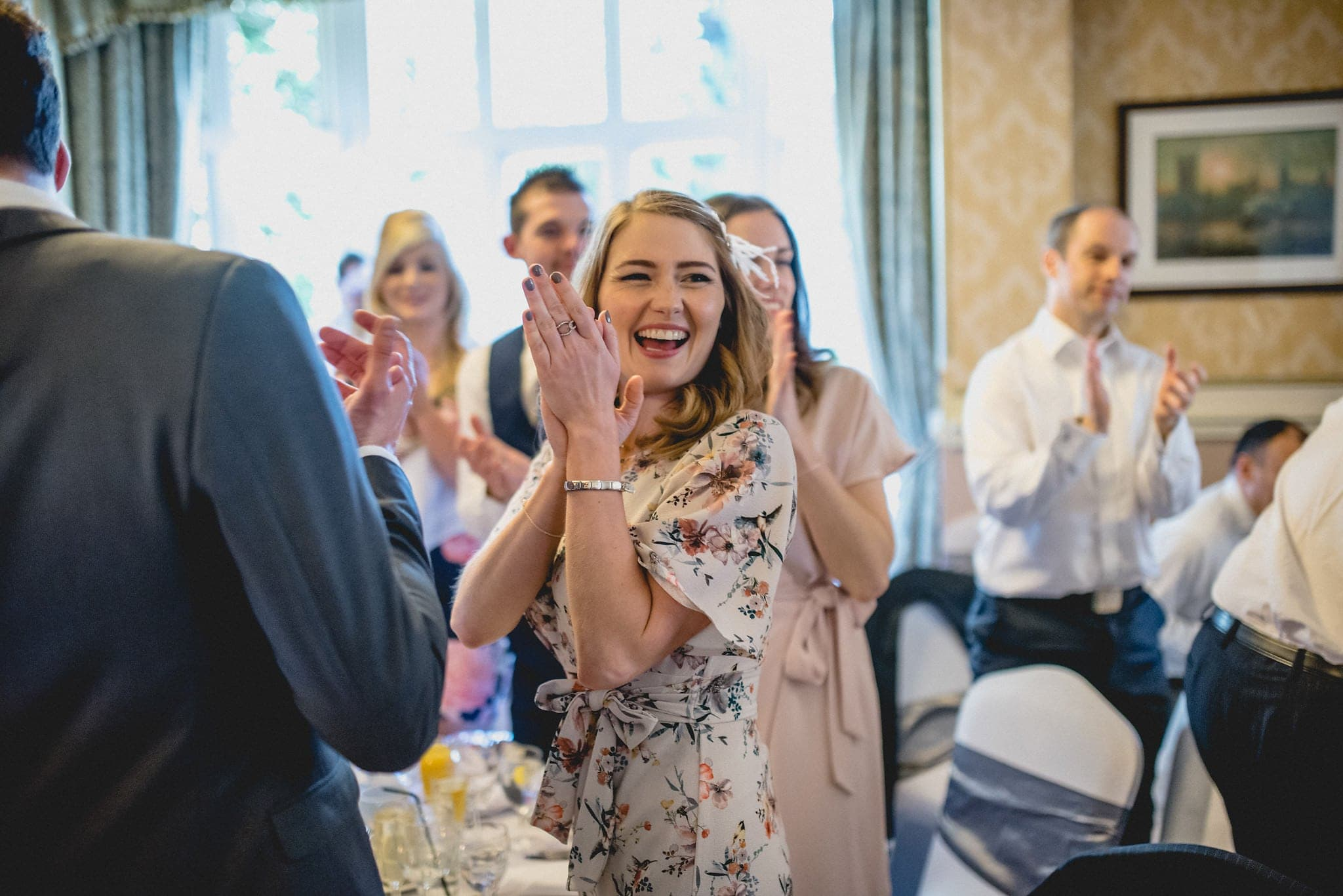 Guests applaud during wedding speeches at Shendish Manor