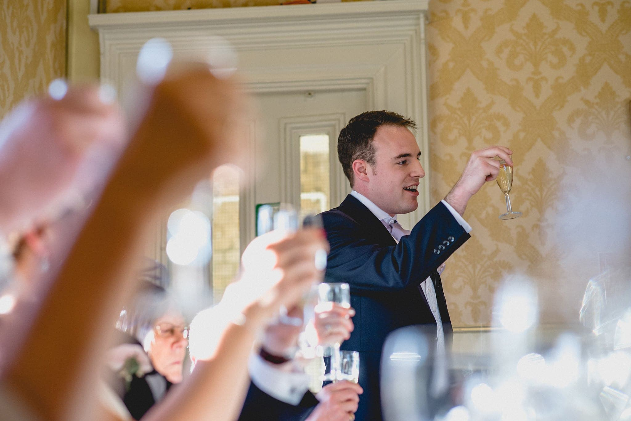 Guests raise a glass during speeches