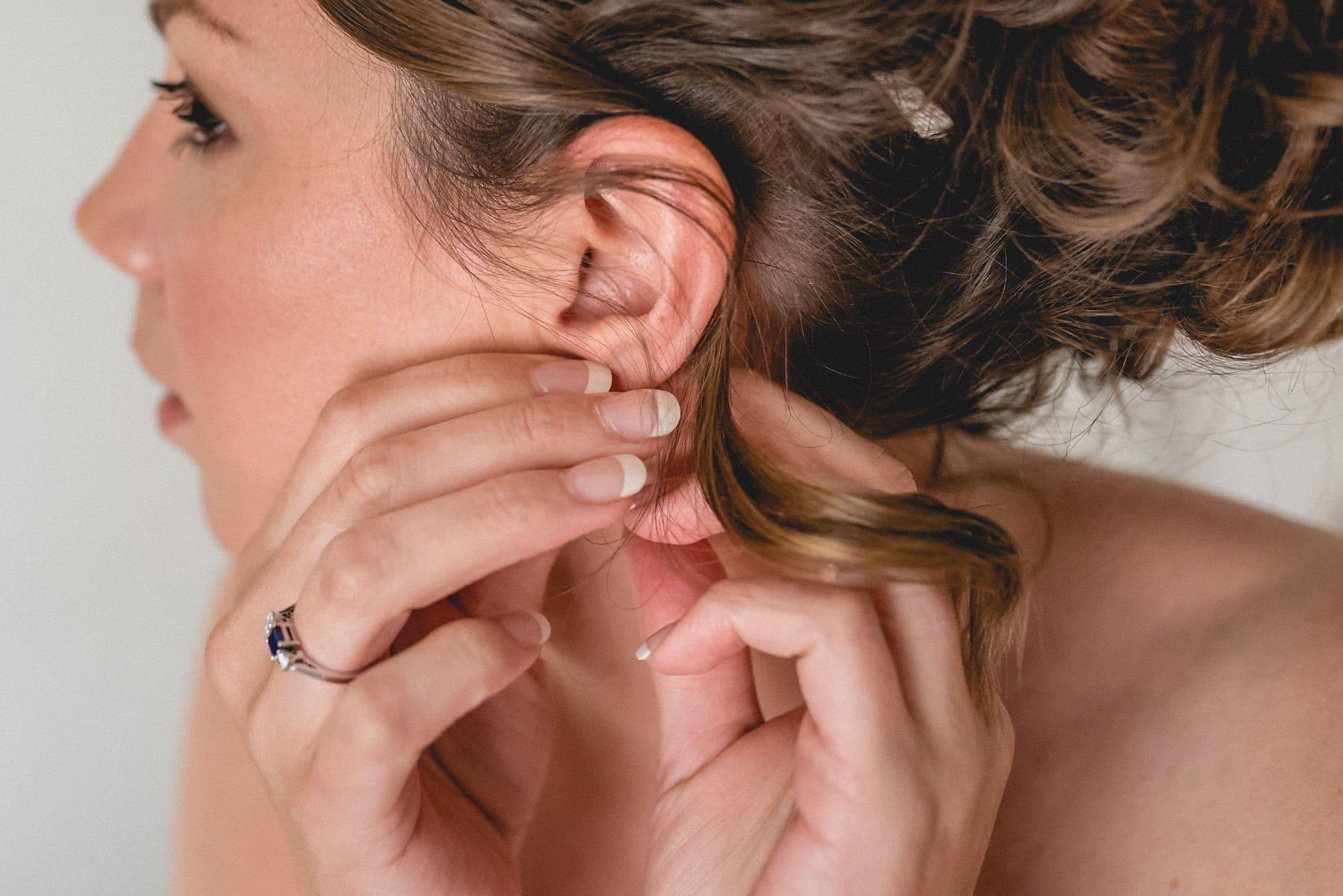 Bride fastens her earring
