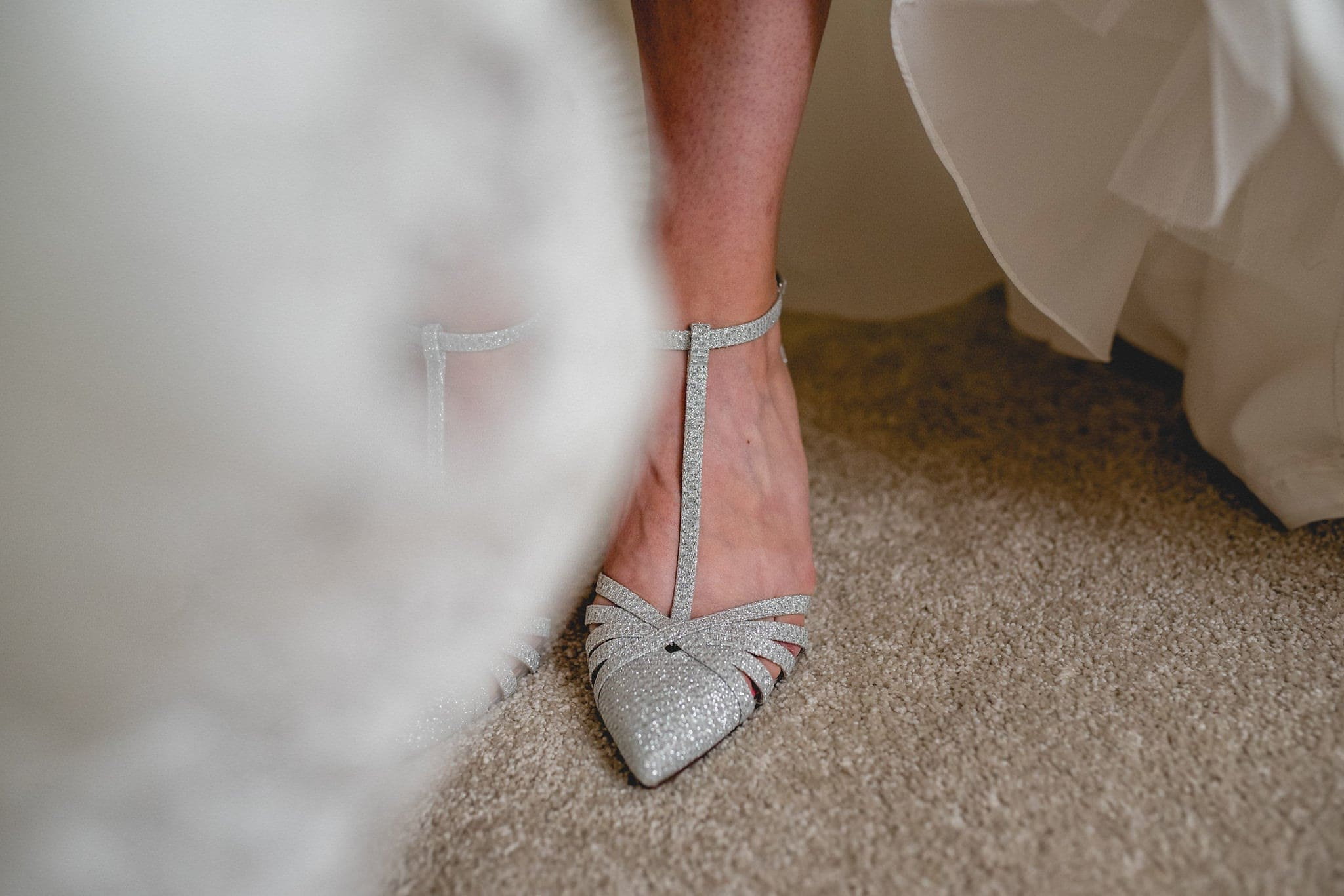 Close up of silver bridal shoes