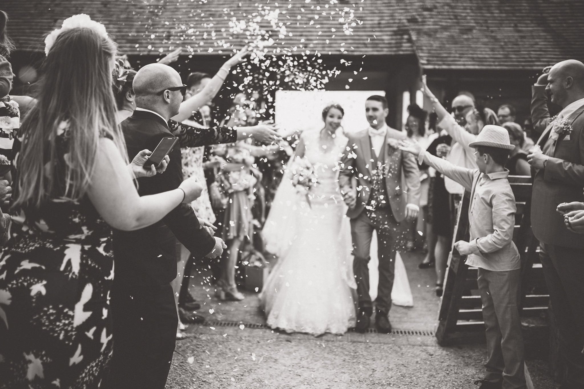 Black and white confetti shot in the courtyard of Fison Barn