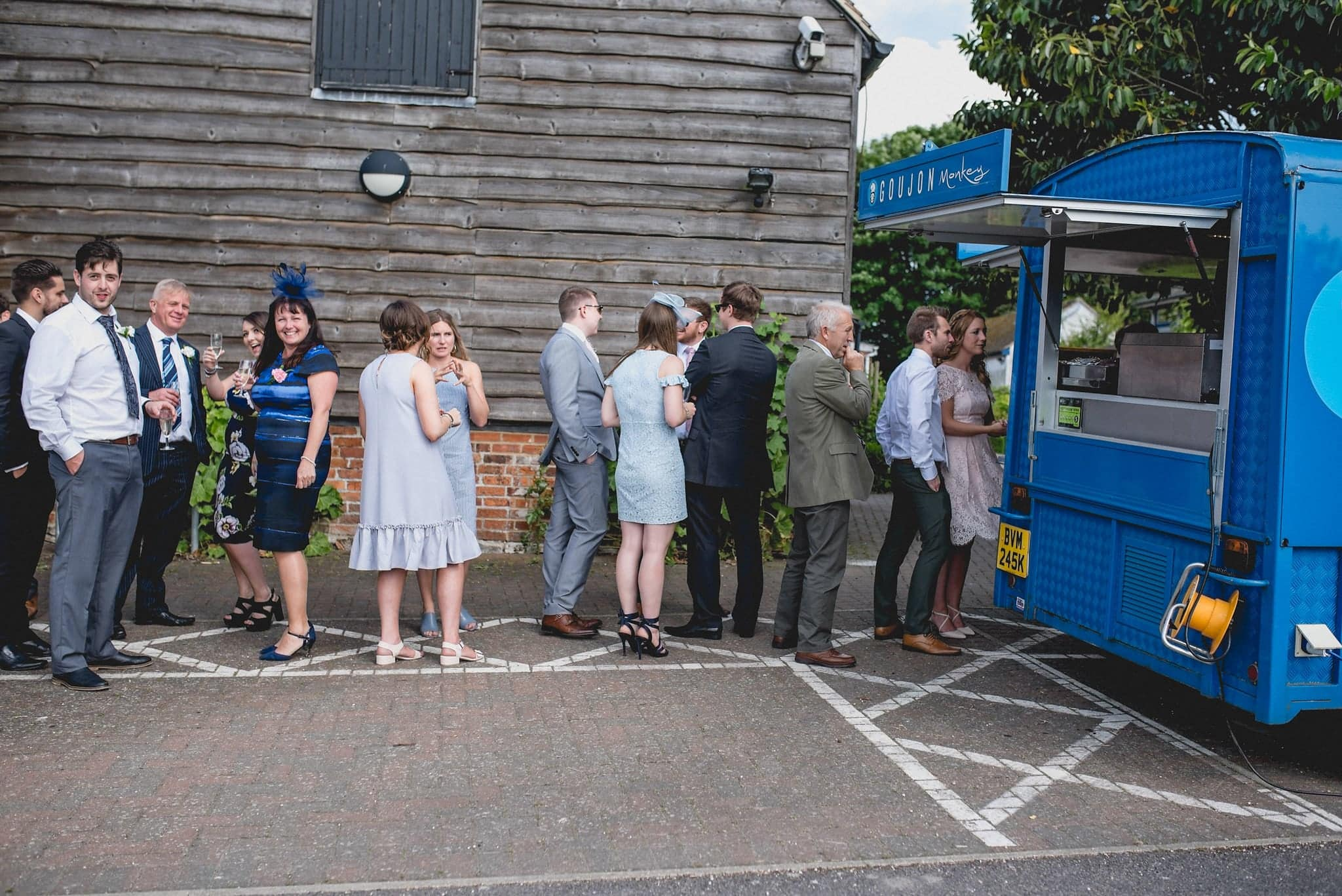 Queue at the fish and chip van during wedding reception