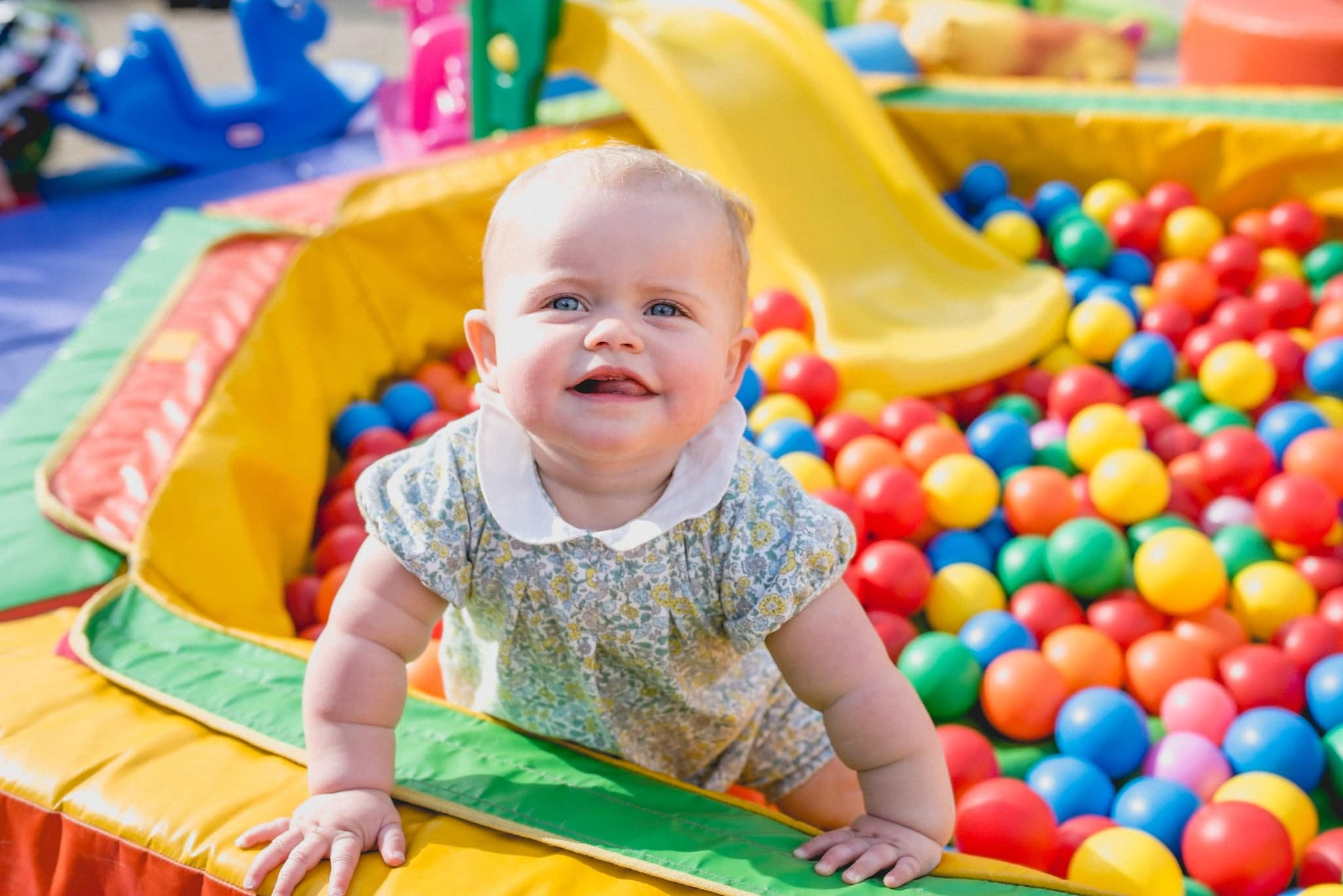 Baby in ball pool at wedding reception