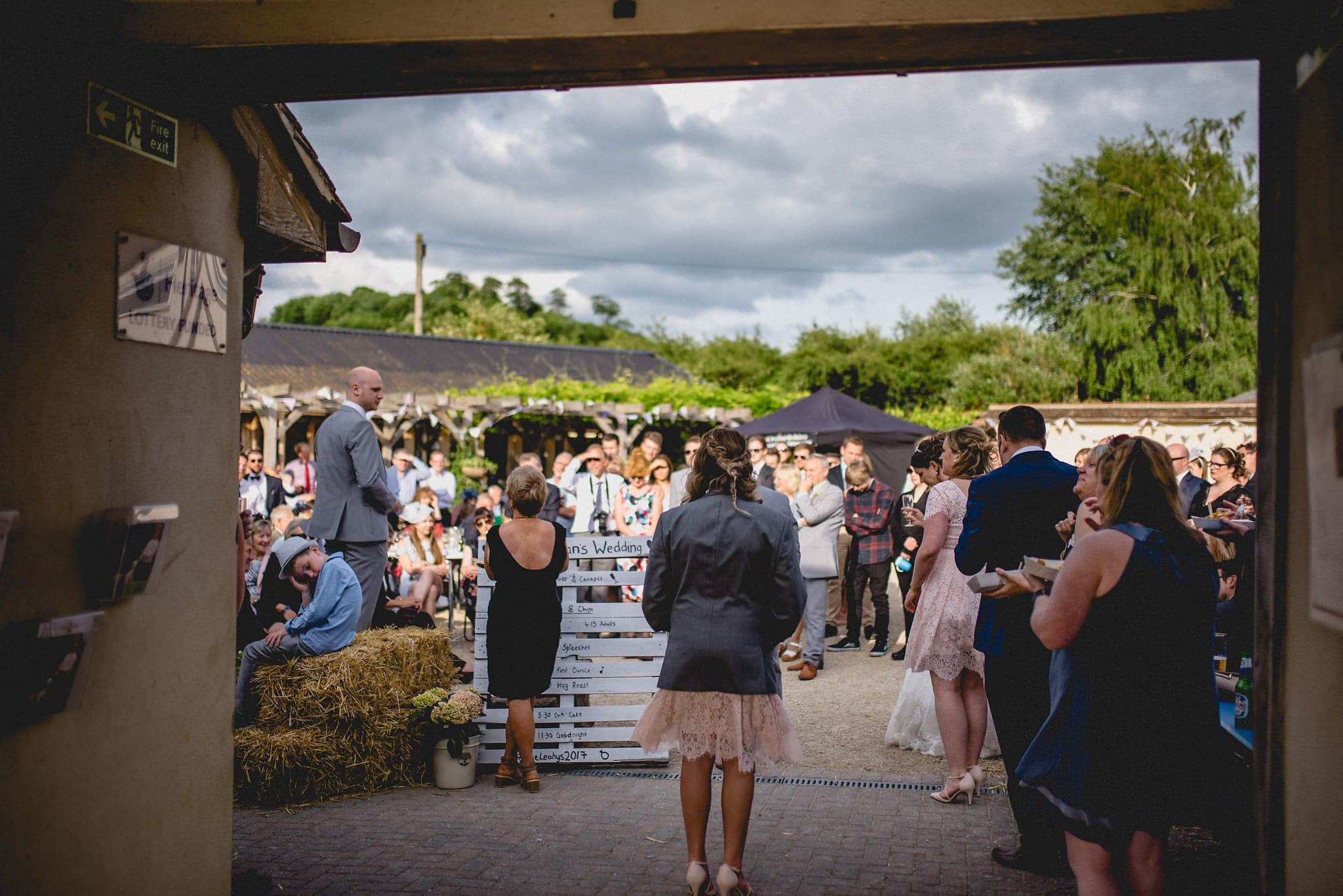 View into the courtyard at Fison Barn during wedding speeches