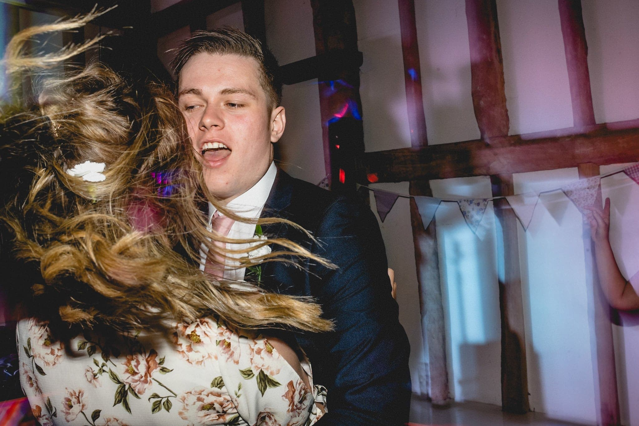 Guests dance to live band at relaxed Fison Barn wedding
