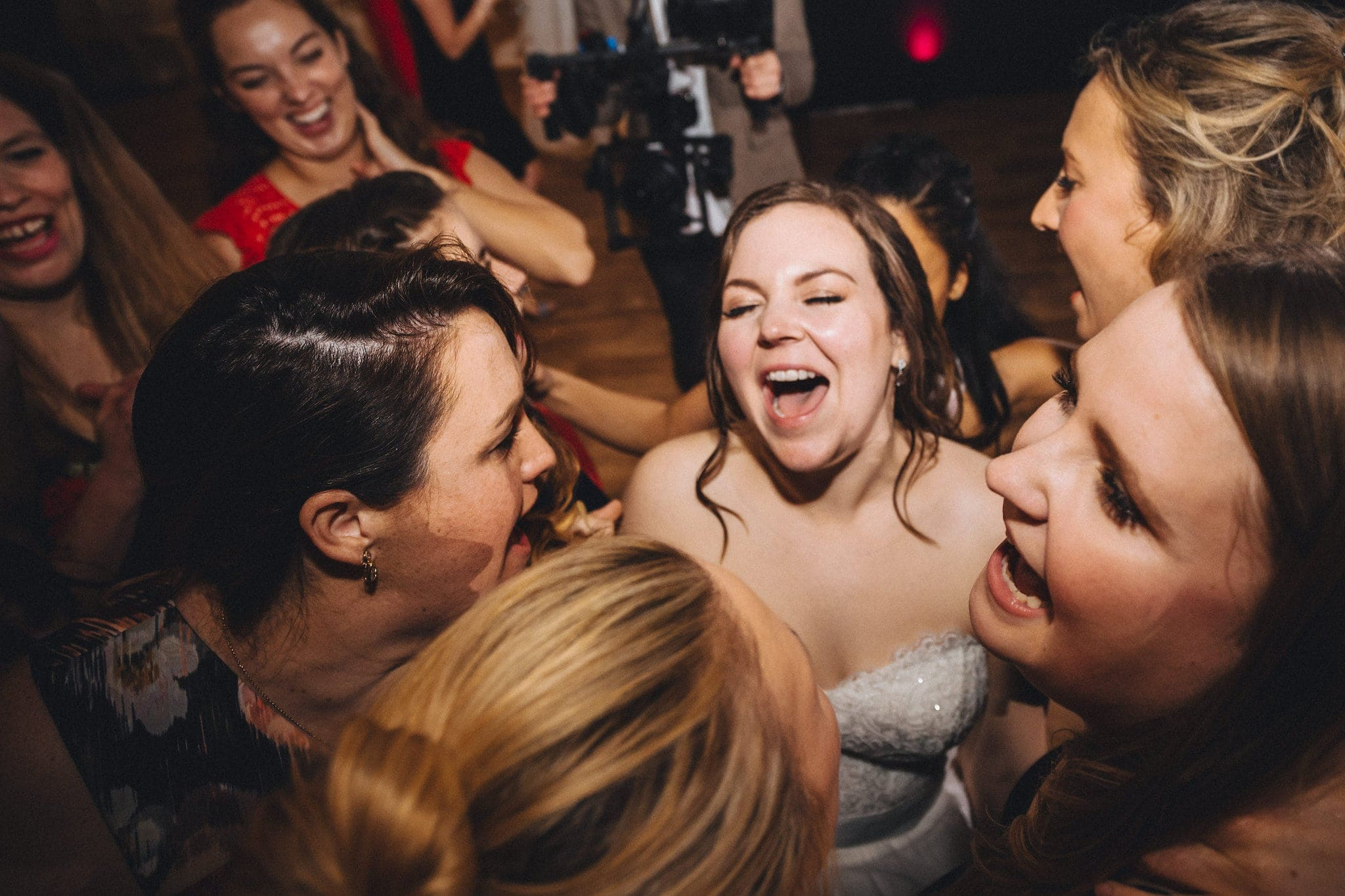 Bride sings loudly with her bridesmaids