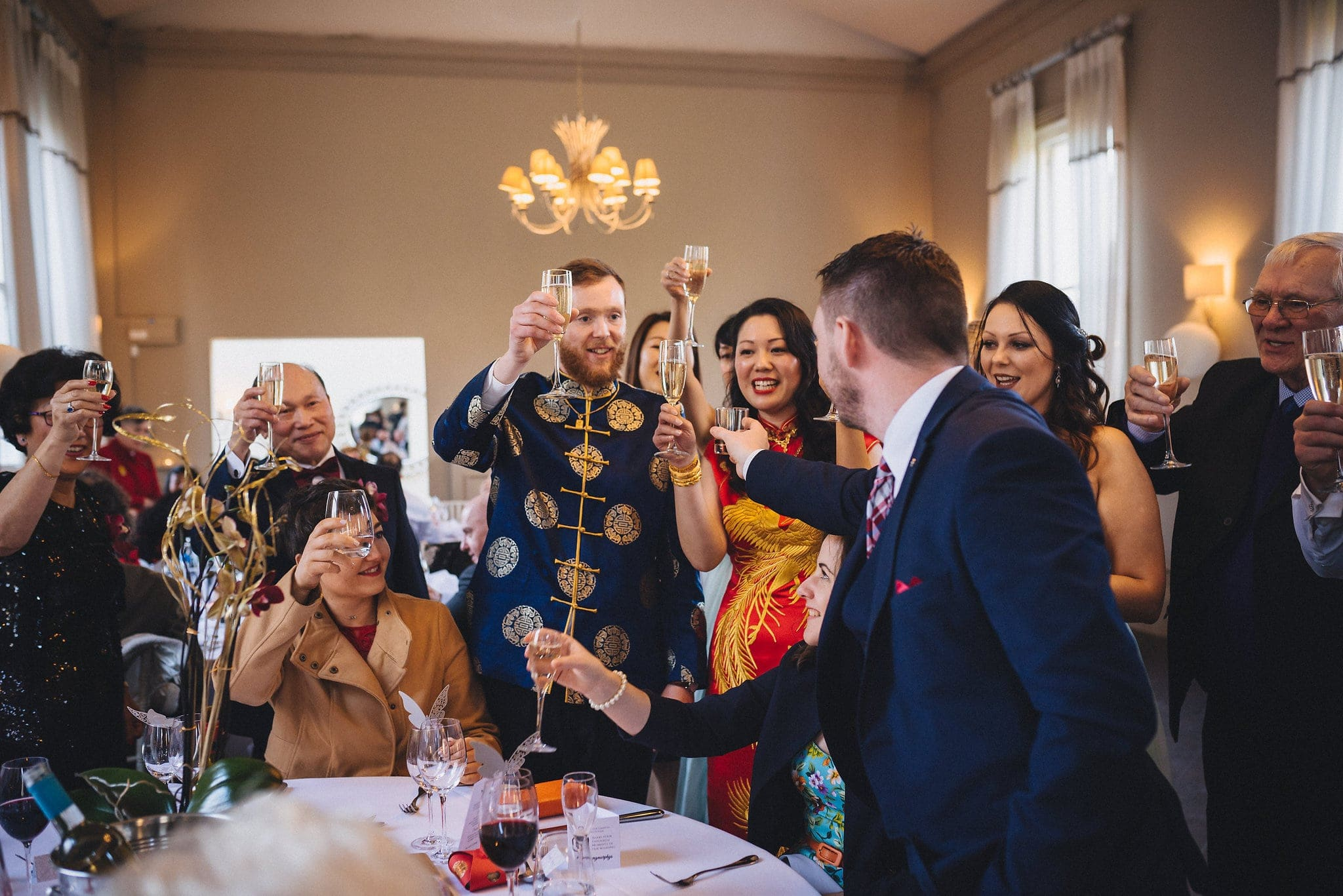Guests at a Morden Hall wedding toast bride and groom with champagne