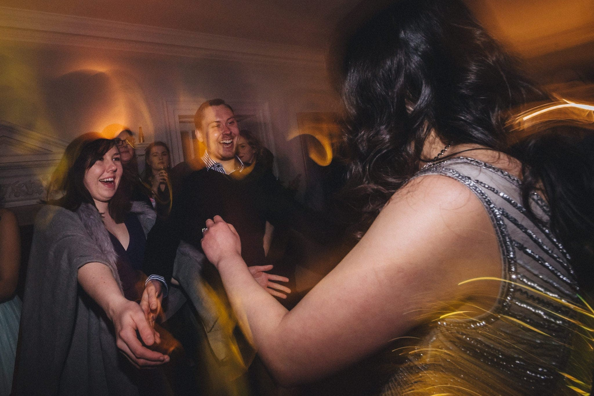 Bride dancing with her wedding guests at Morden Hall