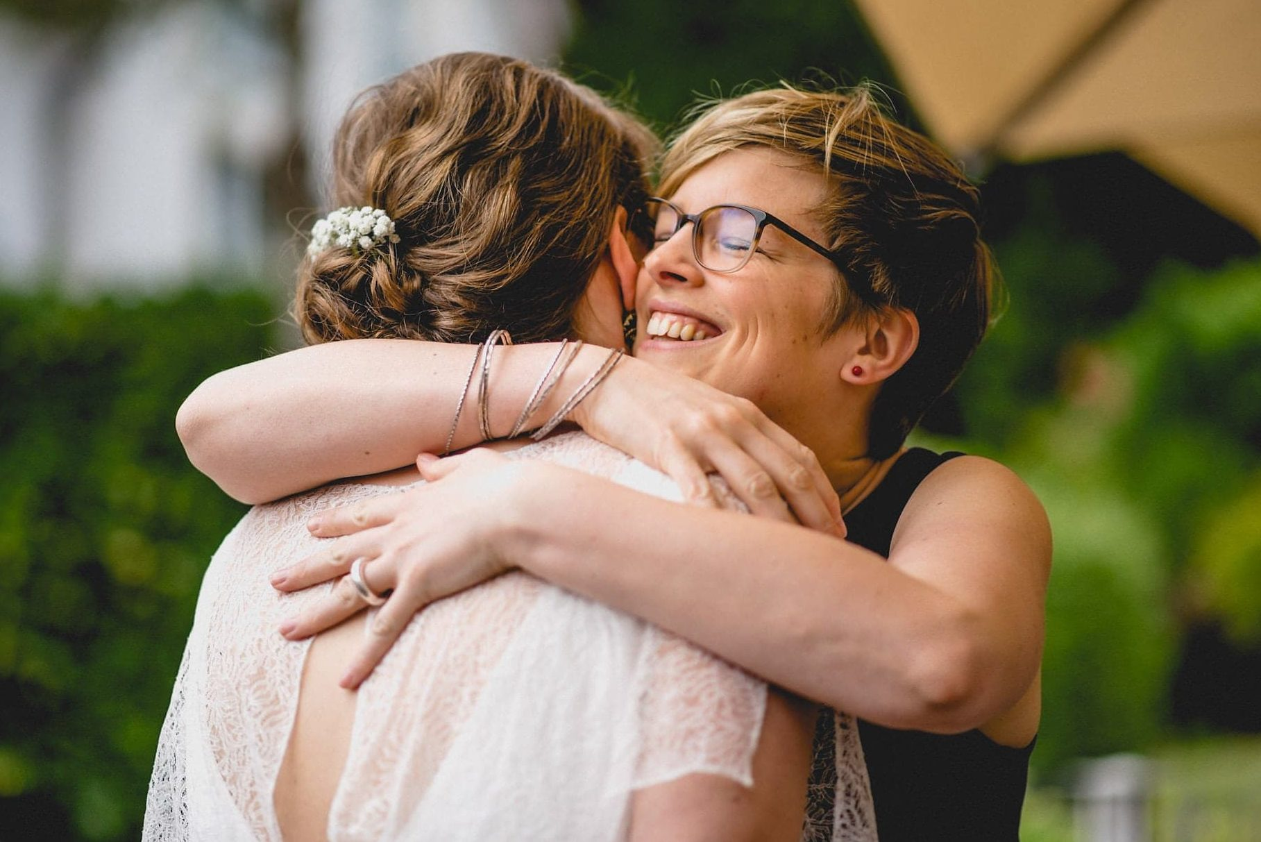 Wedding guest tightly hugging the bride