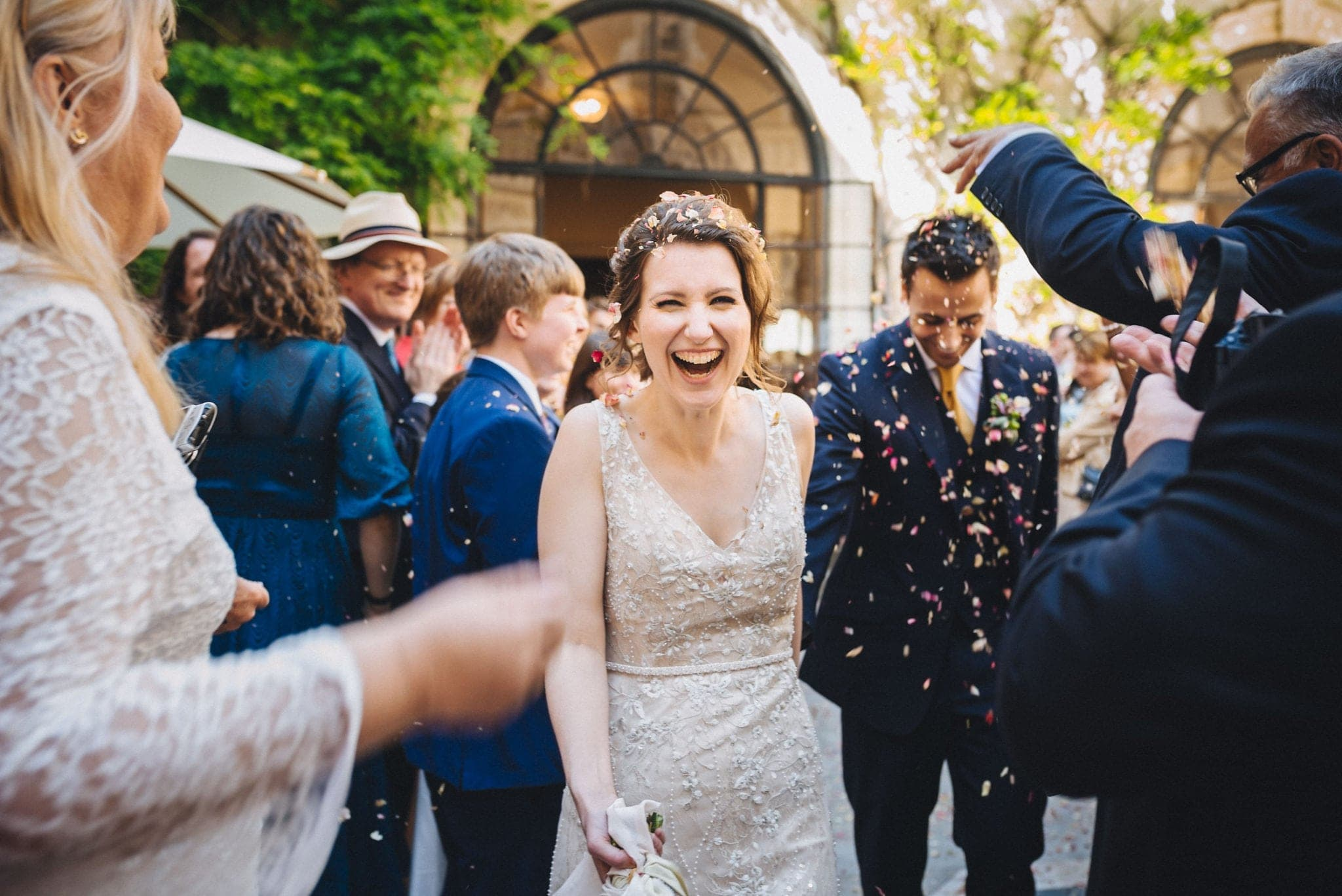 Bride and groom walk through a confetti shower at Merchant Taylor's Hall
