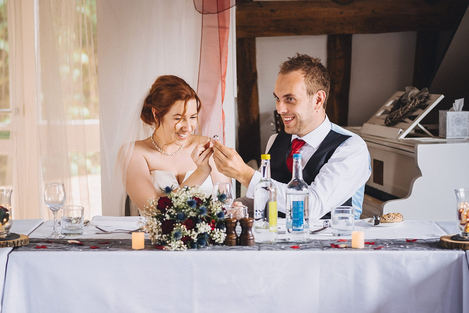 Bride and groom compare the sizes of their wedding rings at their Hever Hotel Wedding