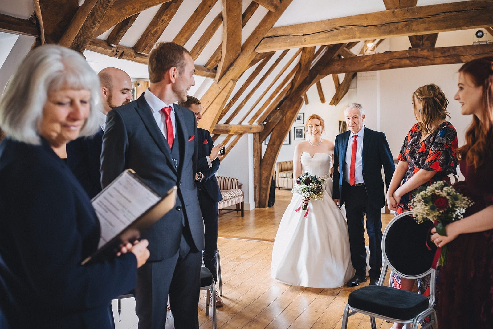 Bride walks down the aisle towards the groom for their microwedding in Kent at the Hever Hotel
