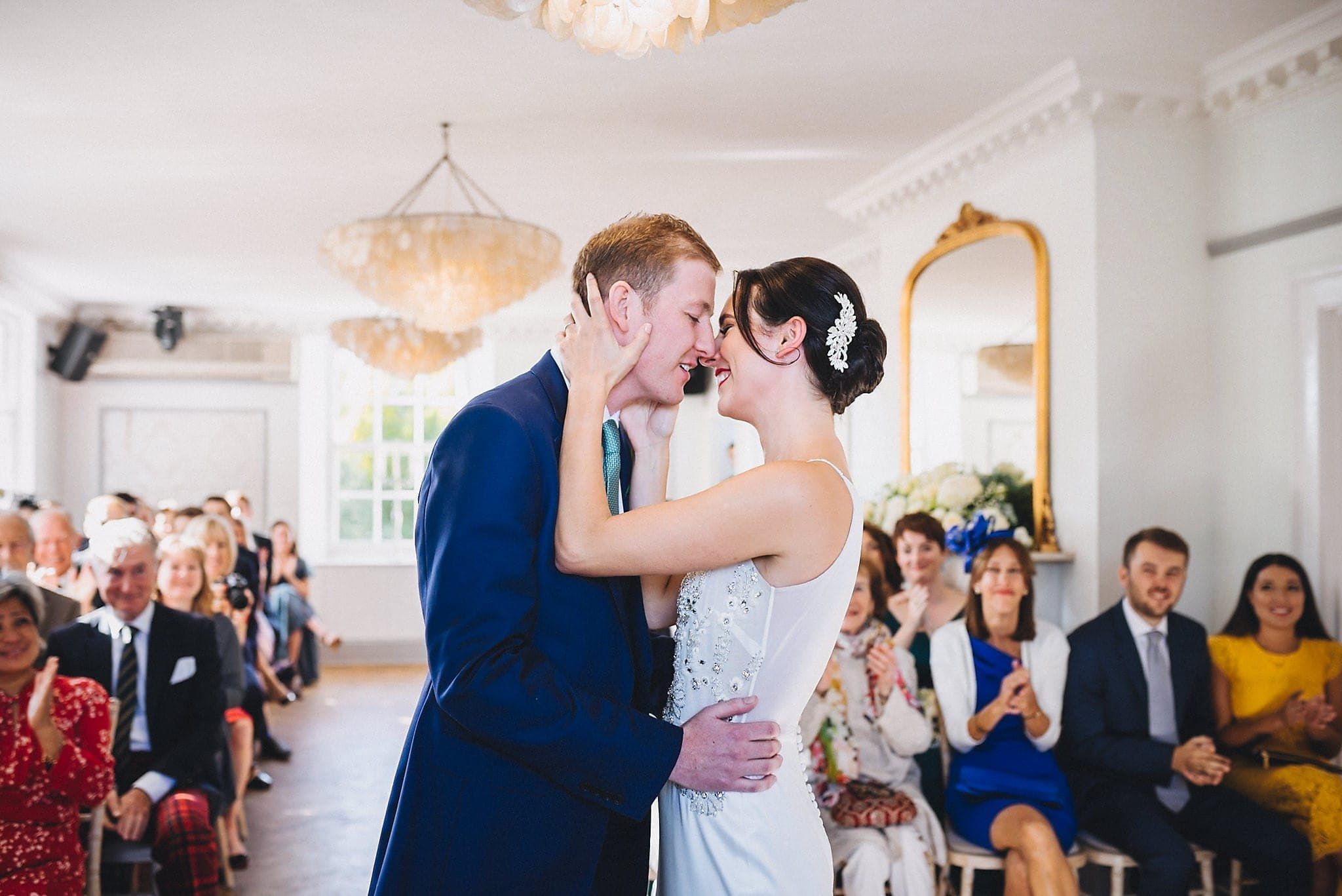 Bride and Groom's first wedding kiss at their Elegant Late Summer Belair House Wedding