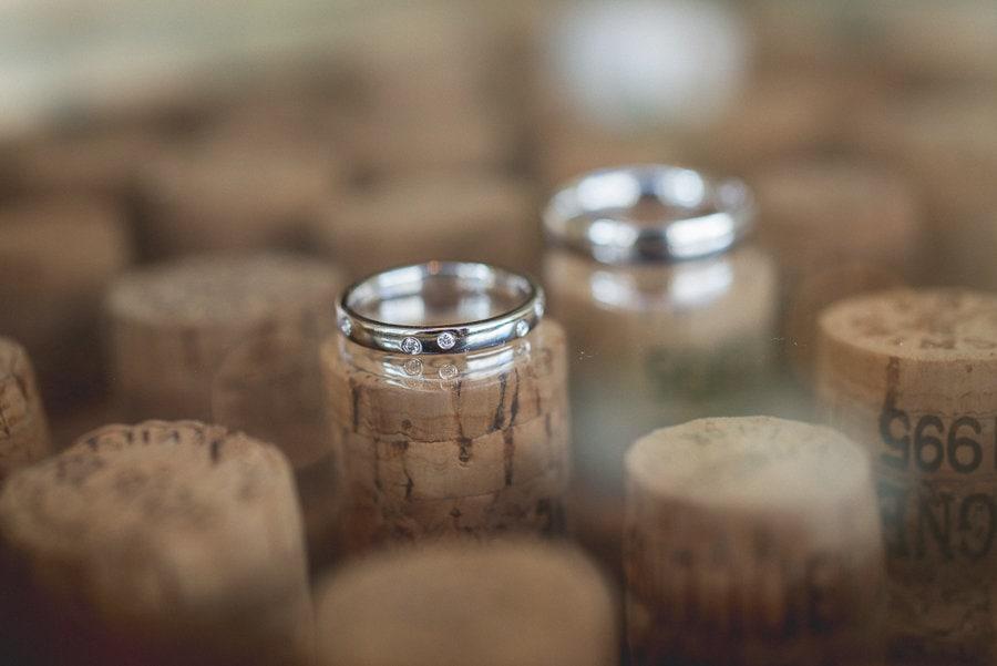 Wedding rings displayed on corks