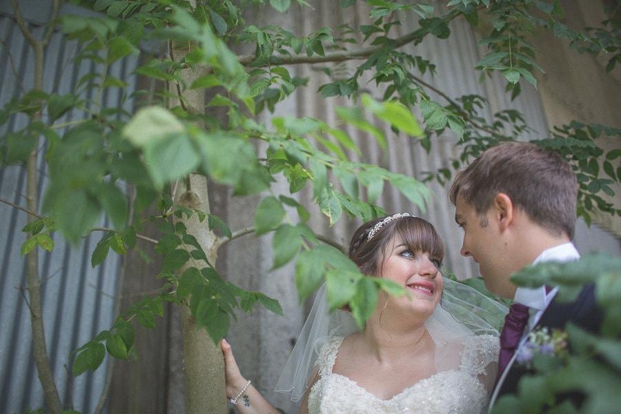 Bride and Groom hugging at their rustic Kent barn wedding venue