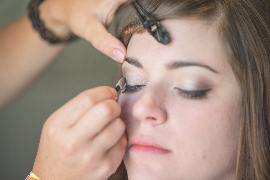 Bride's make up being done for her Summer Rustic Barn Wedding