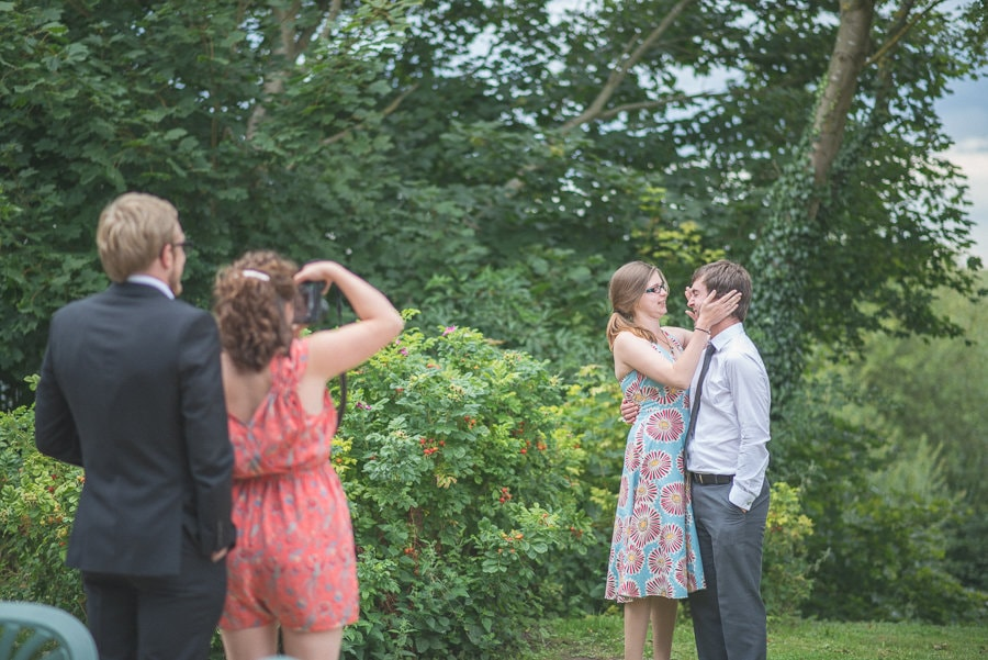wedding guests taking photos of each other