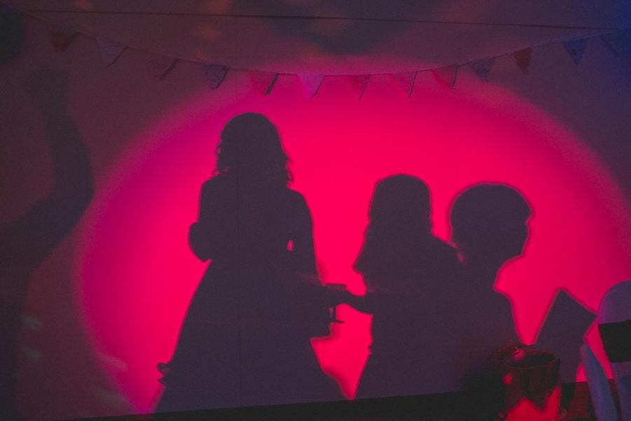 shadows of wedding guests dancing