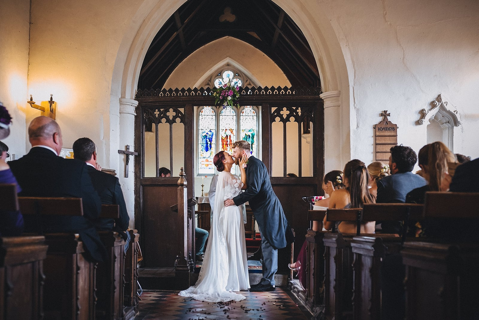 Bride and Groom kiss at their Cambridge Church ceremony