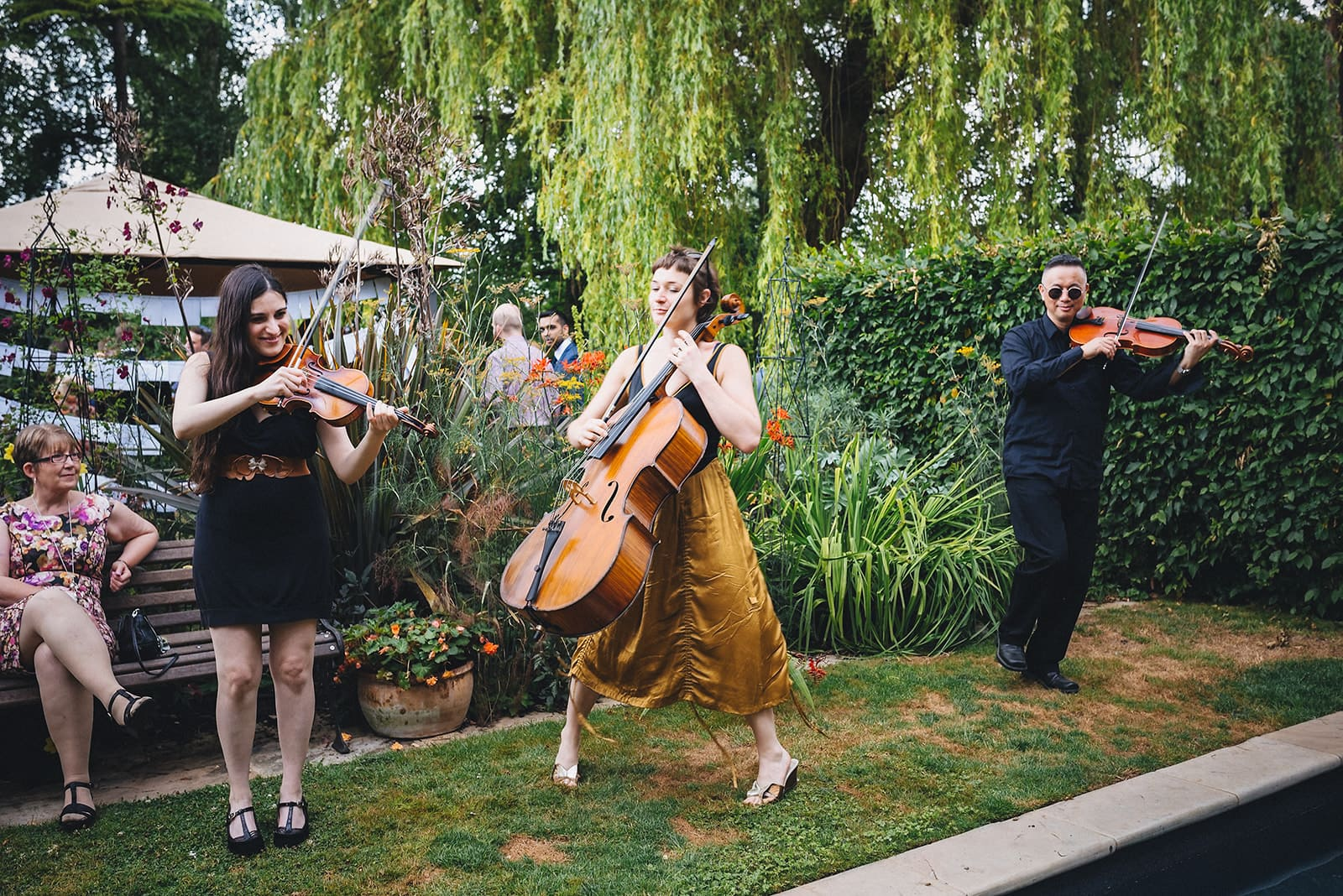 Roving string quartet entertaining wedding guests at a Cambridge Farm Wedding