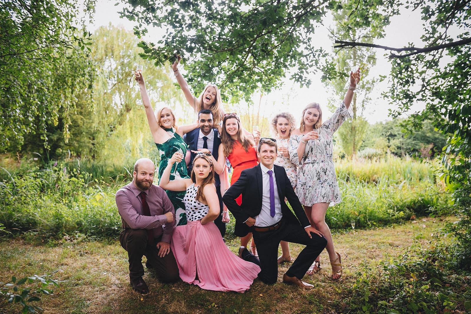 unposed fun natural wedding group shot