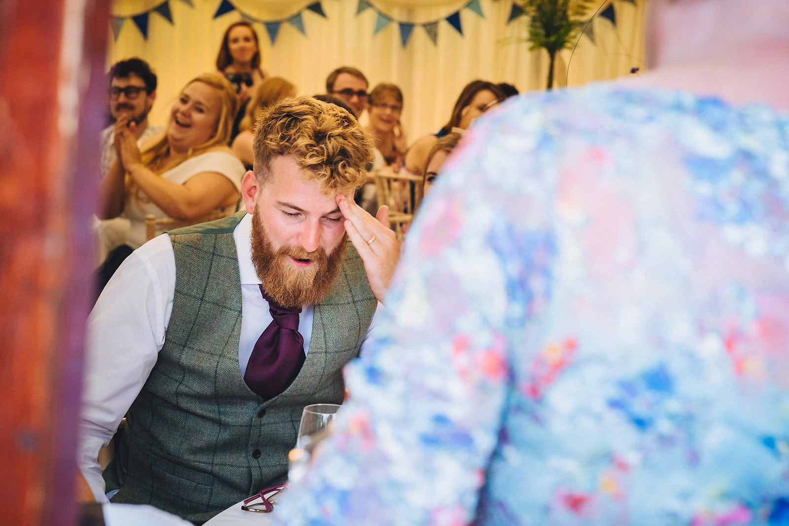 Groom pulling an embarrassed face during his mums speech