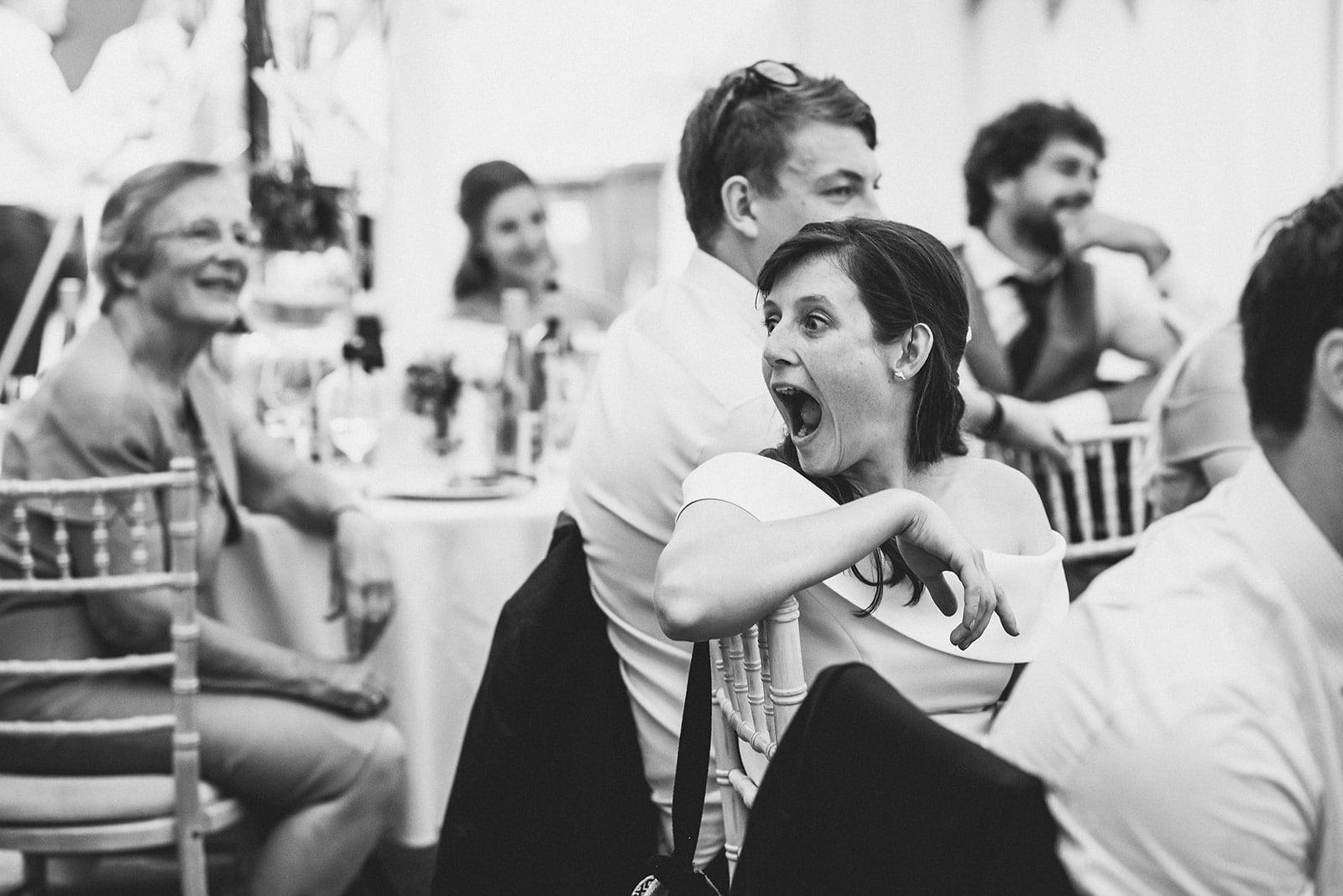 Bridesmaid guffawing during a wedding speech
