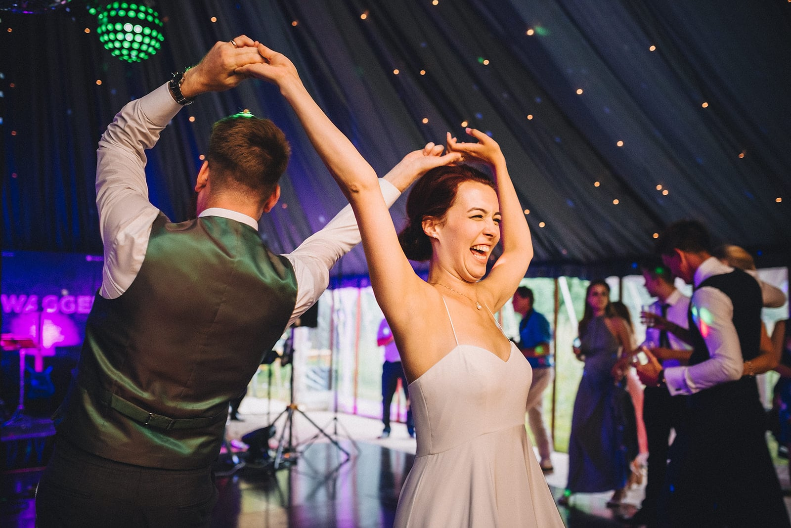 Dinosaurs, Laughter & an epic party for a Joyful Cambridge Farm Marquee Wedding