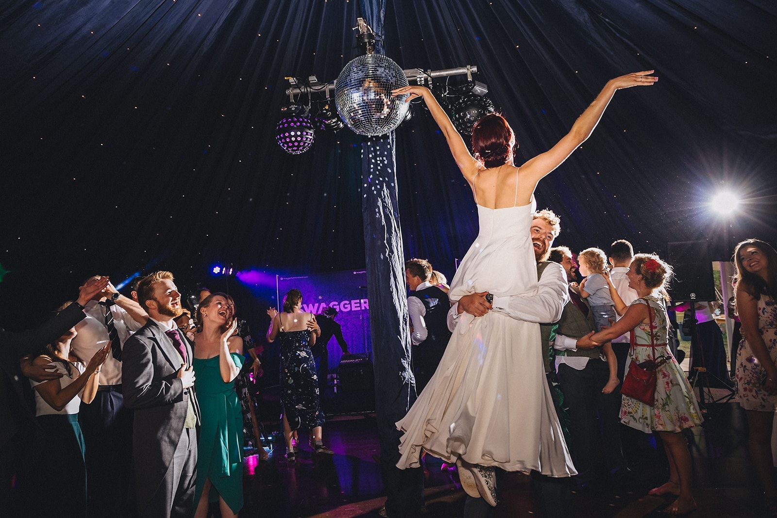 Groom lifting the bride in a Dirty Dancing lift during their first dance