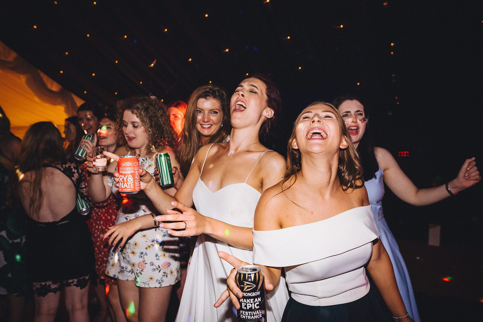 Bride and bridesmaids sing out loud at a wedding party
