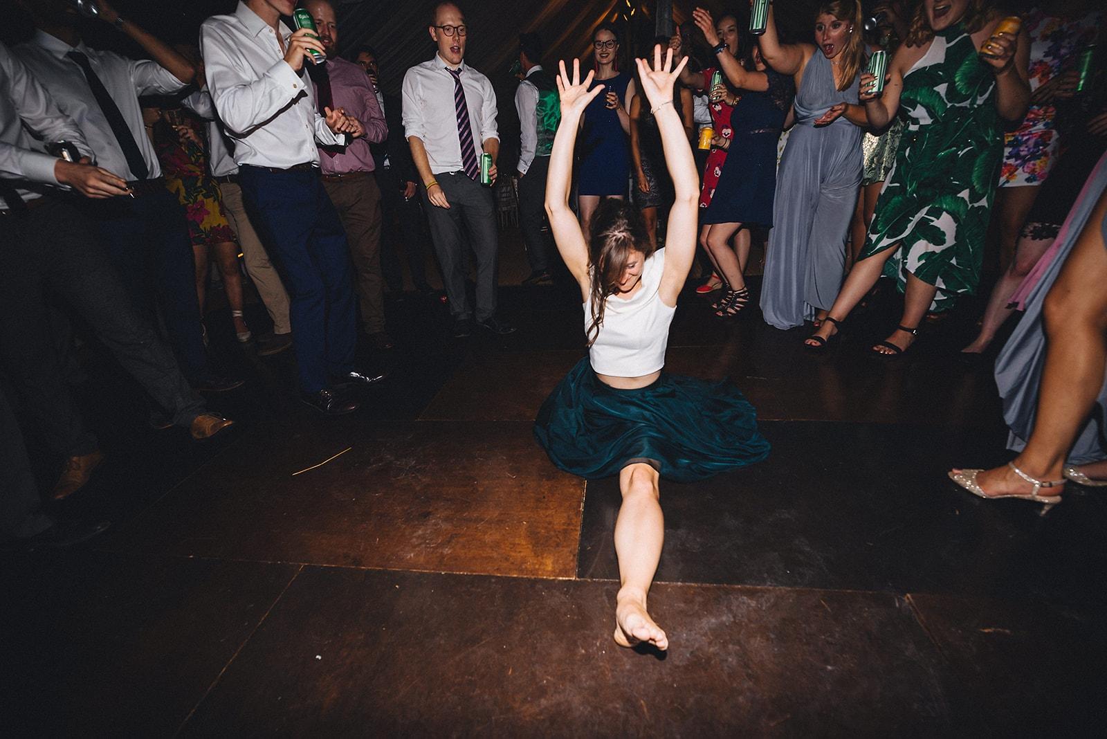 Wedding guest doing the split on the dance floor
