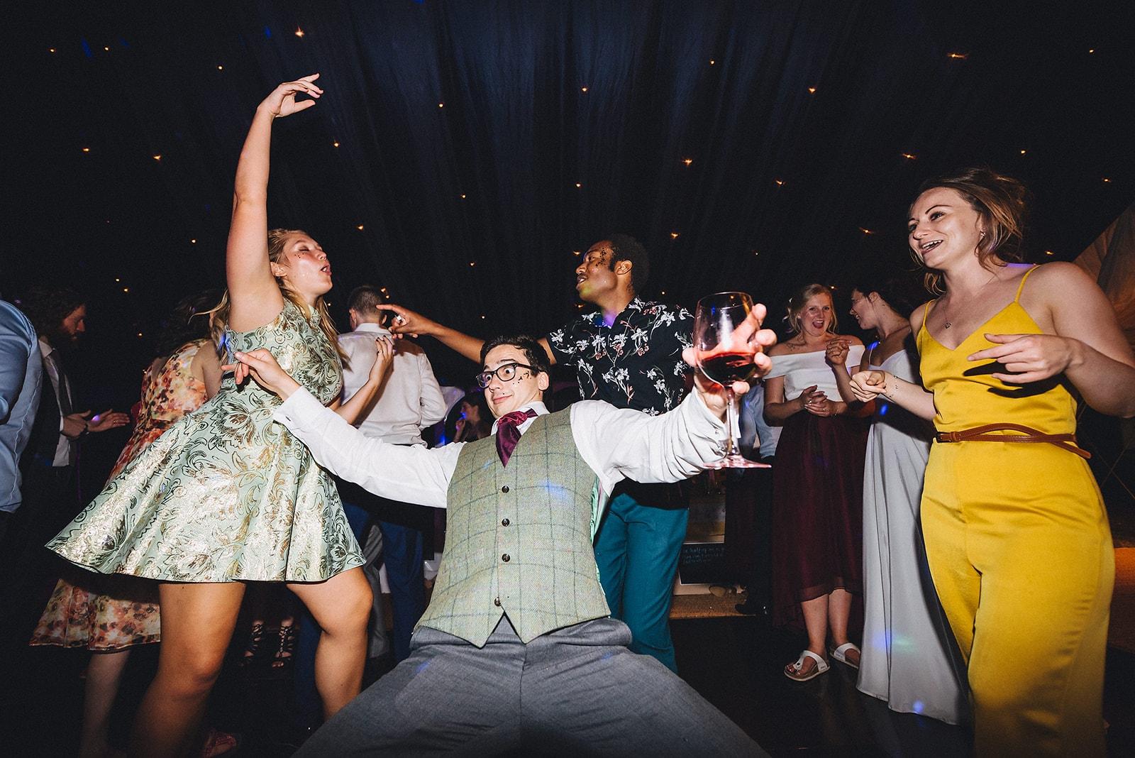 Wedding guests dancing at a cambridge farm marquee wedding