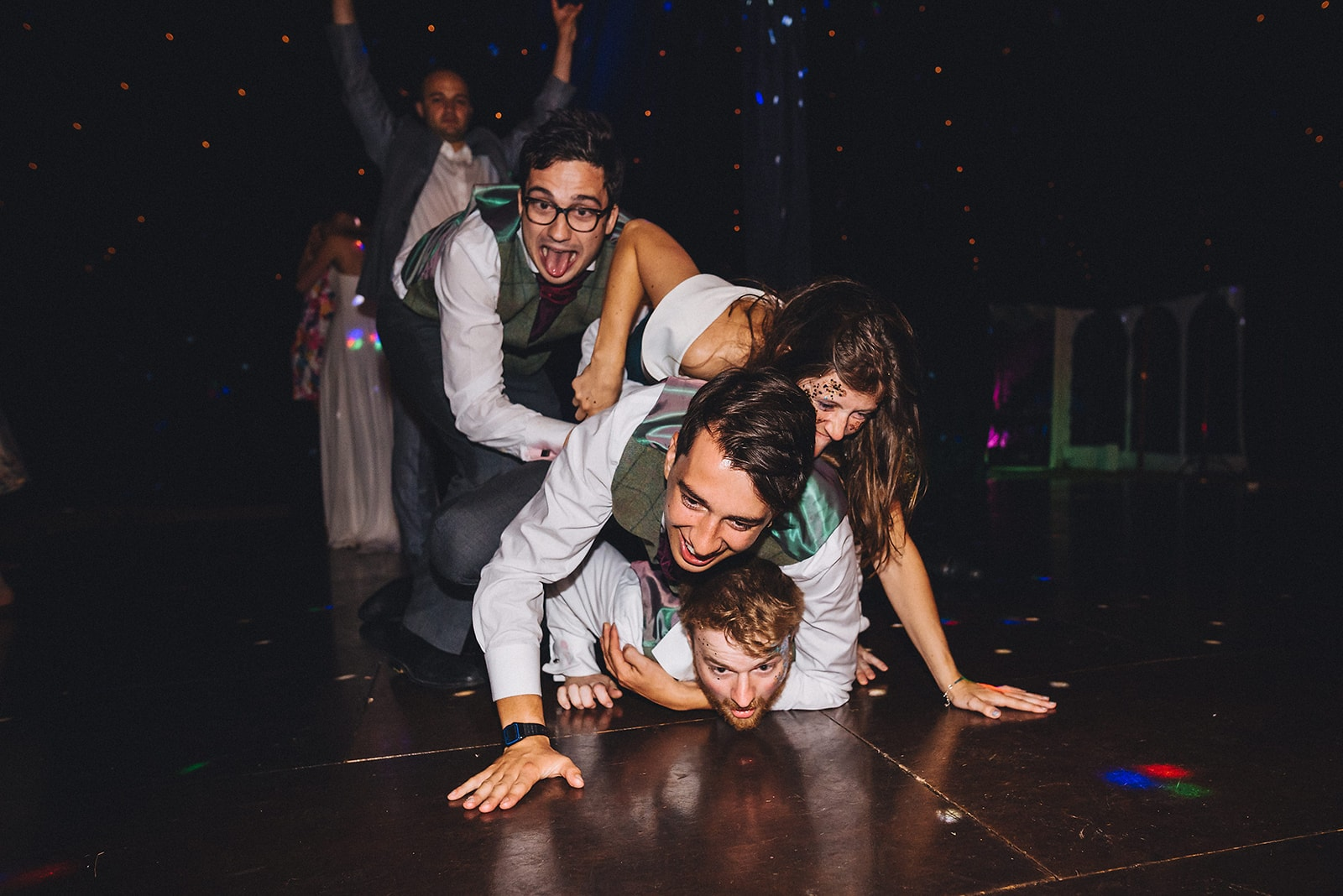 Wedding guests tumble to the floor during the wedding party