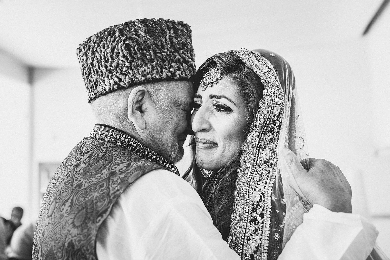 Emotional Granddad hugging the teary bride at her Traditional Moroccan Destination Wedding