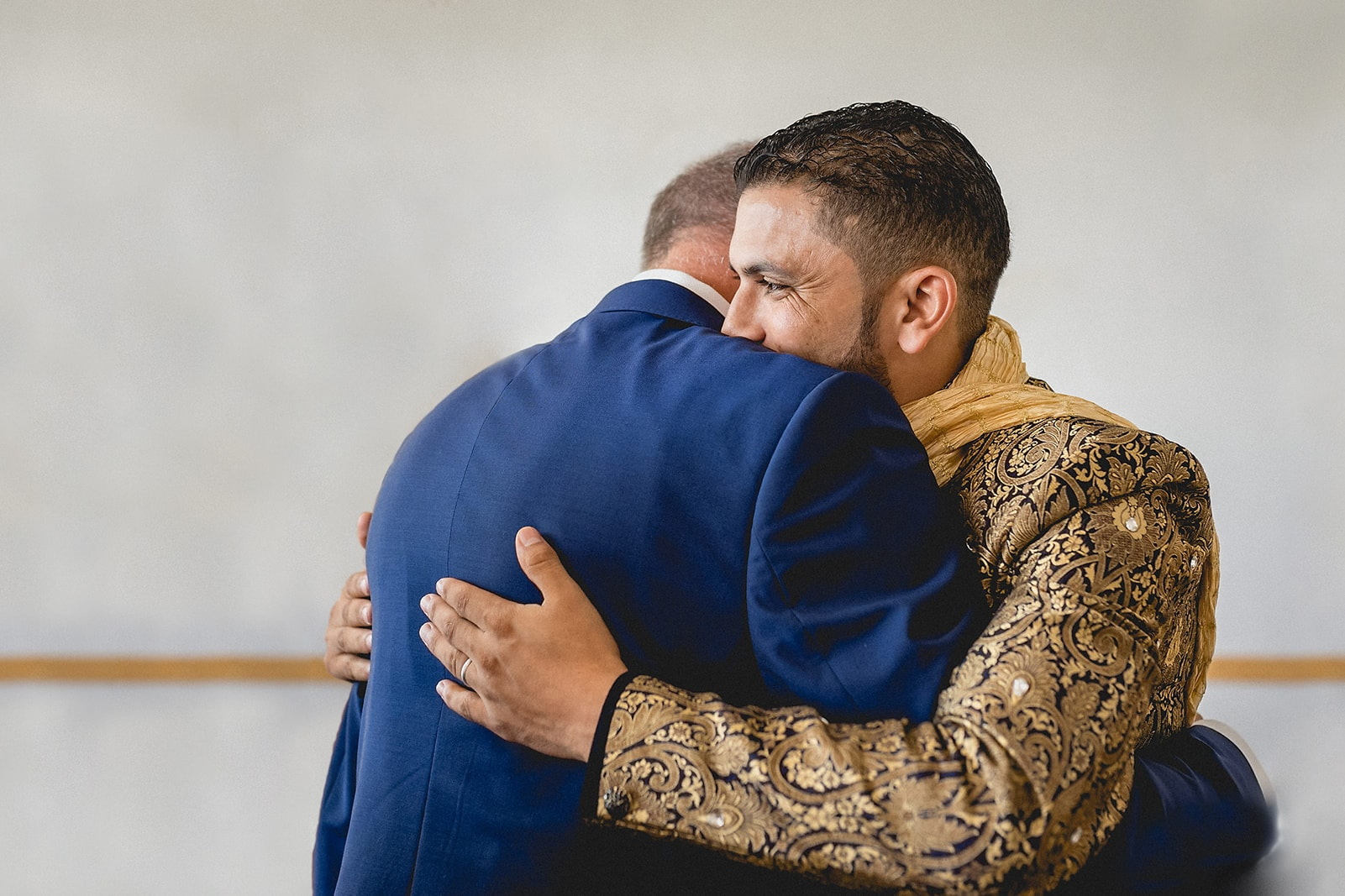 Moroccan Berber groom hugging his father at the end of his Traditional Moroccan Destination Wedding