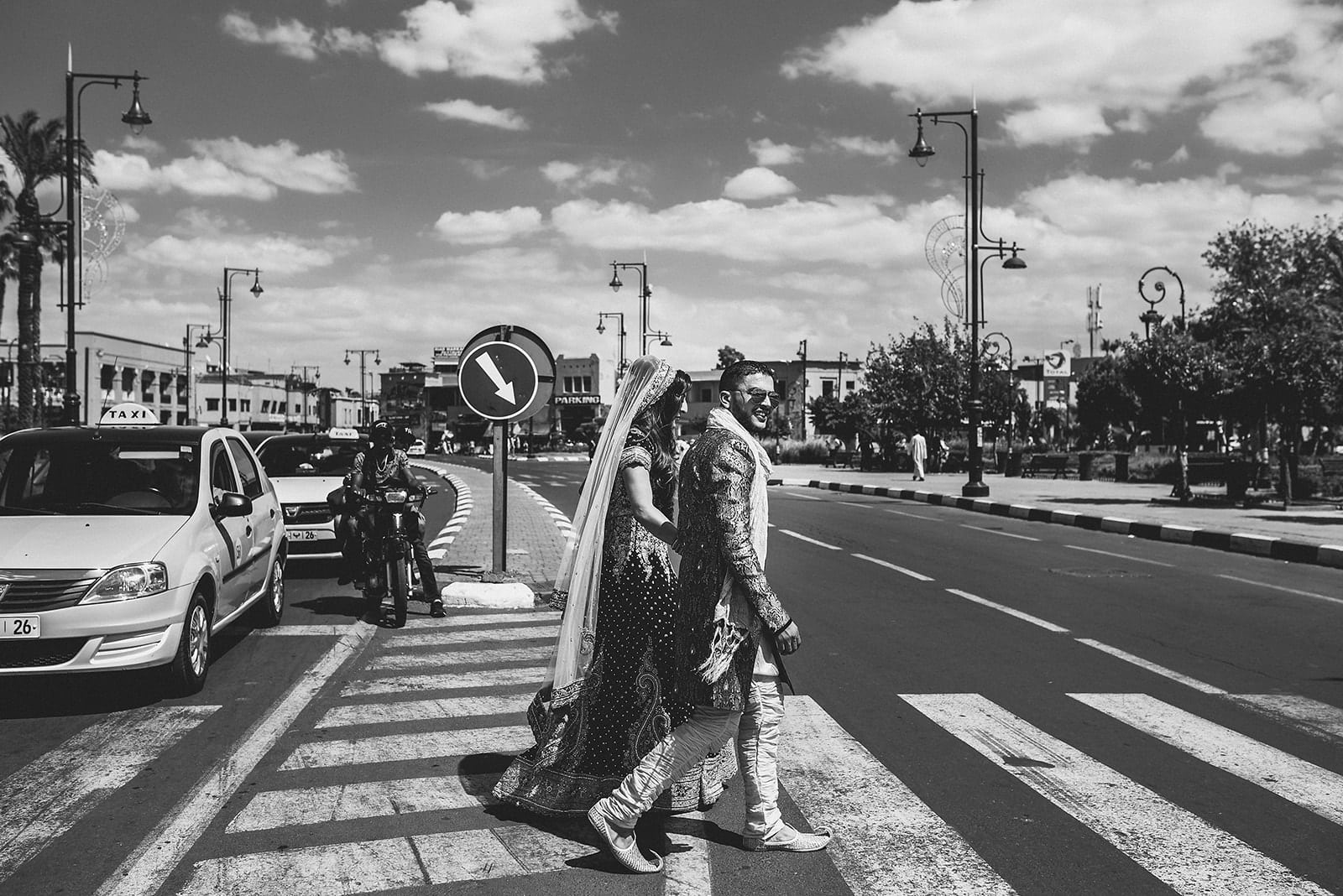 Bride and Groom walk towards Djemaa el Fna square and the souk in Marrakech