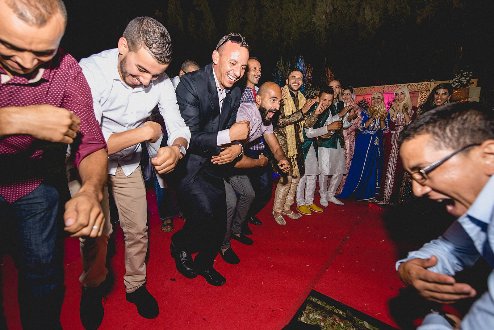 Berber guests dancing at a destination wedding in Marrakech