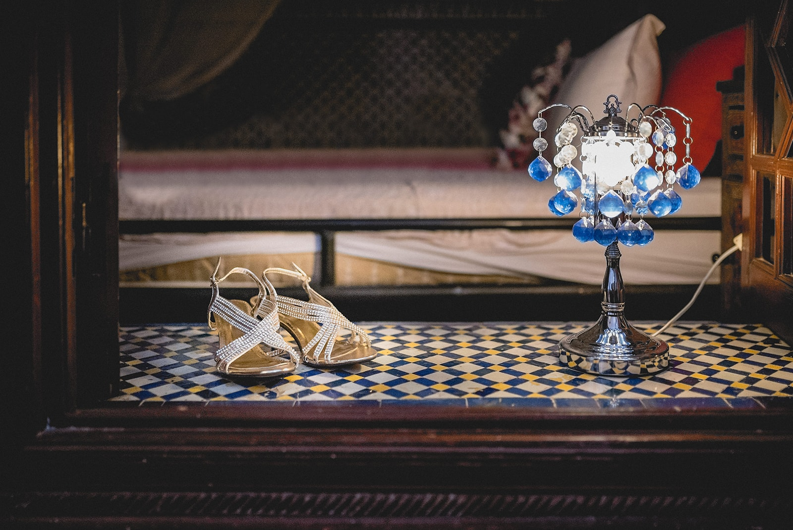Bride's shoes resting on Moroccan tiles in the window of her bridal suite