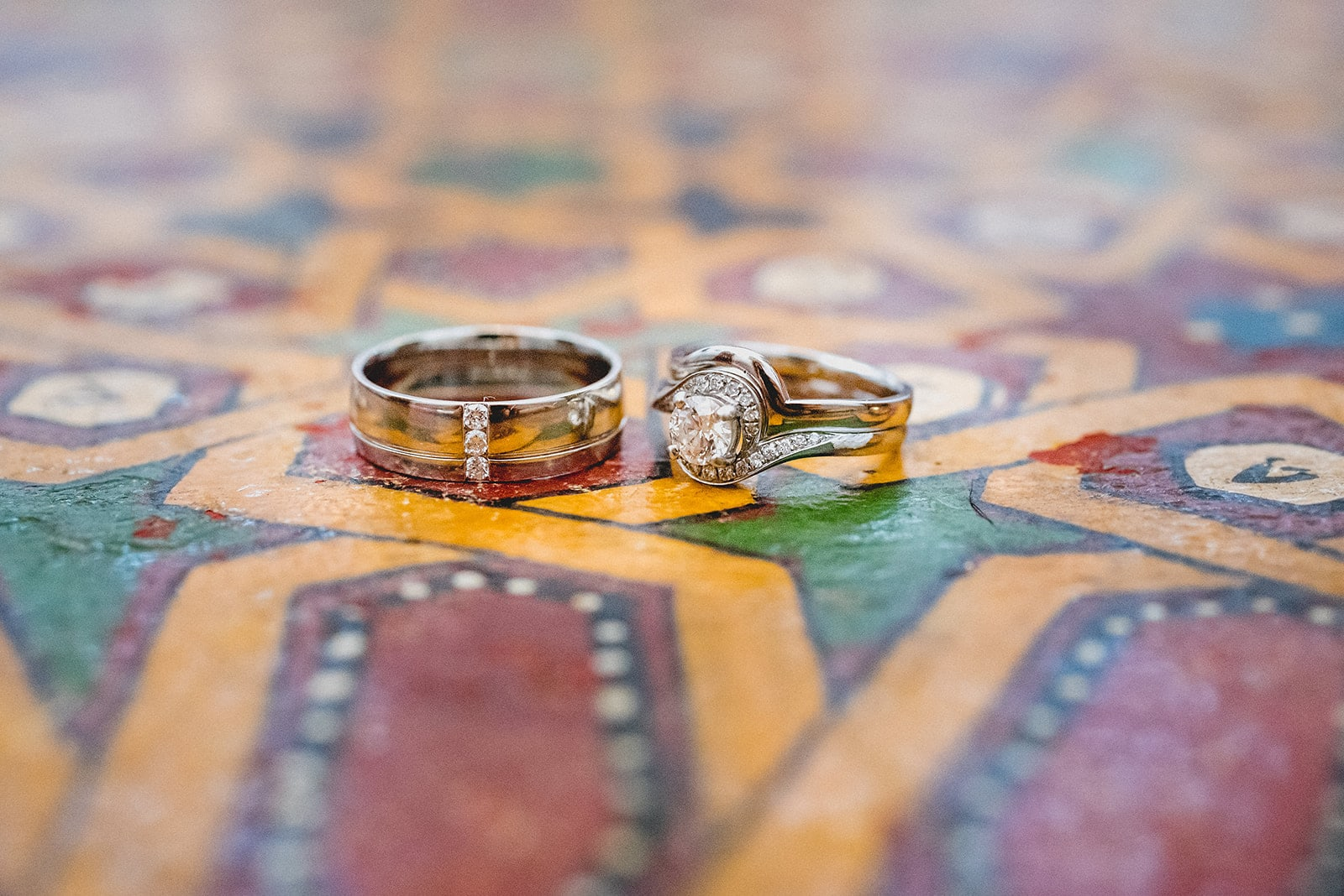 Wedding rings lying on colourful Moroccan pattern