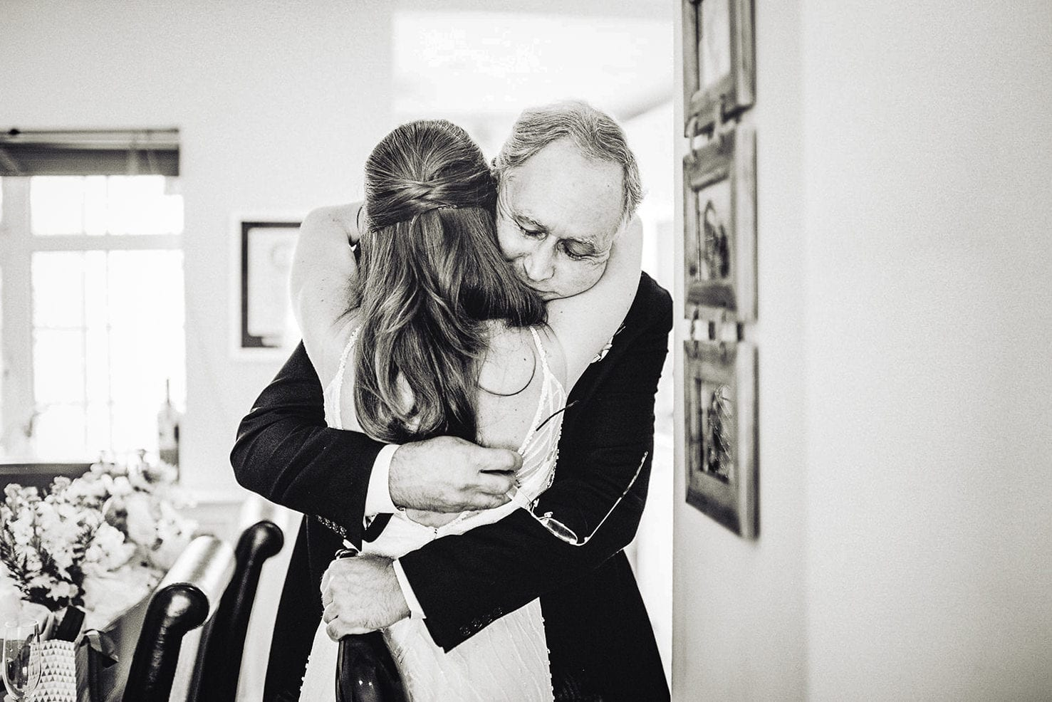 Bride's father hugs her tight before leading for her Fulham wedding ceremony