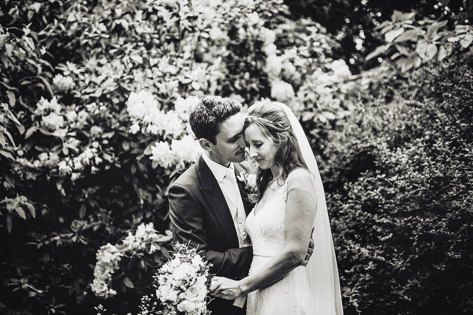 Bride and Groom hug in the Hurlingham Club's sunken garden
