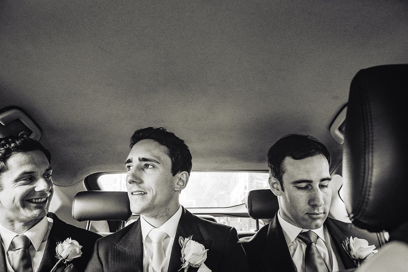 Groom travelling to his Hurlingham Club wedding with his groomsmen