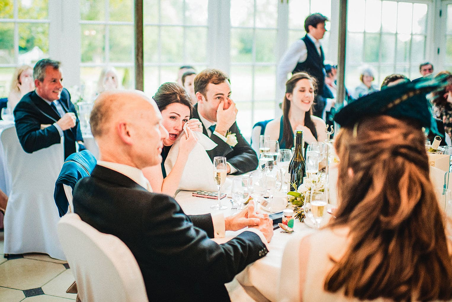 Wedding guests wipe tears in the Terrace Room at the Hurlingham Club