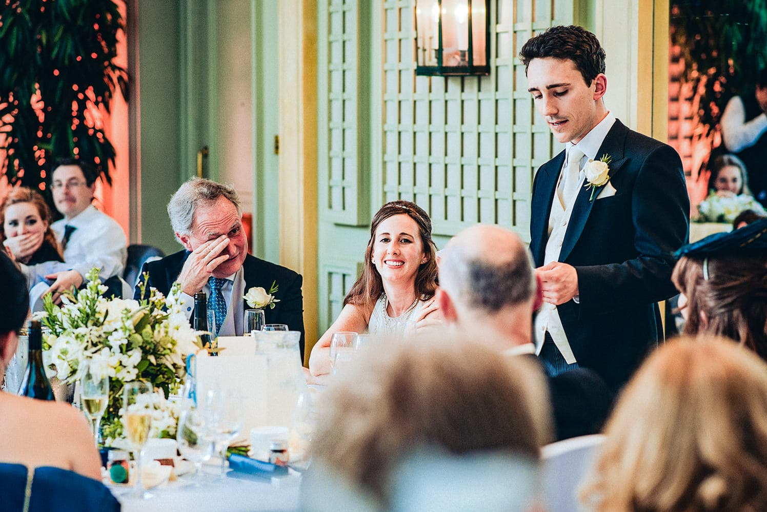 Father of the bride wipes a tear at the groom's speech in the Hurlingham Club Terrace room