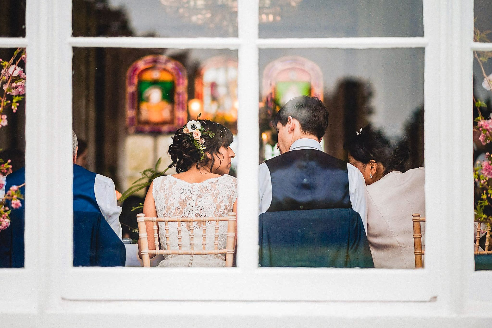 Bride and Groom seen sitting through a glass window