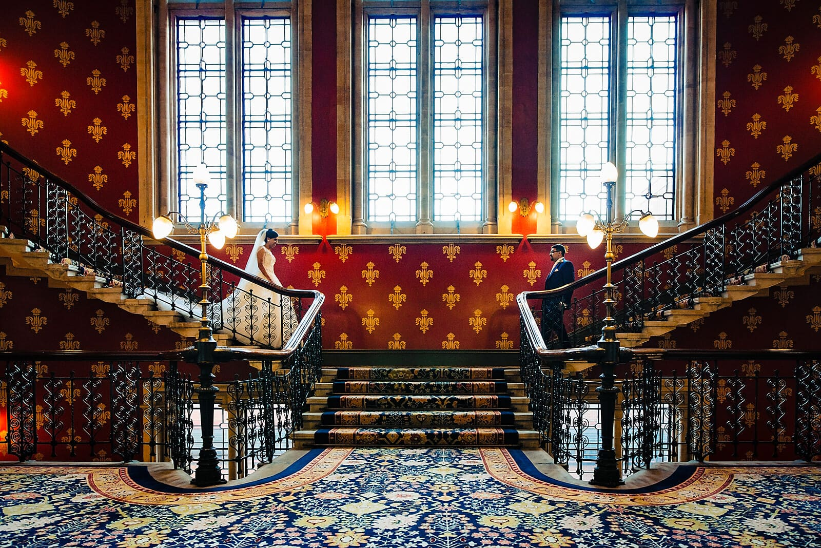 Bride and groom walk down the stairs at their St Pancras Renaissance Hotel Wedding